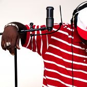 picture of rapper  - Male artist wearing headphones in studio setting - JPG