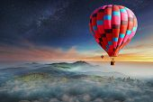 Colorful hot-air balloons flying over the mountain with with stars. Beautiful mountains landscape poster