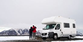 stock photo of recreational vehicle  - Travelling couple with Mobile motor home RV campervan driving through Iceland in recreational vehicle - JPG
