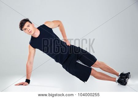 Portrait of a fitness man warming up isolated on a white background