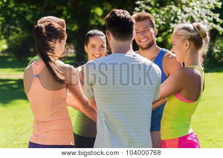 fitness, sport, friendship and healthy lifestyle concept - group of happy teenage friends or sportsmen with hands on top outdoors