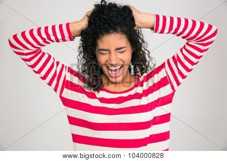 Portrait of afro american woman screaming isolated on a white background