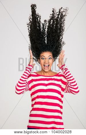 Portriat of scared afro american woman screaming isolated on a white background