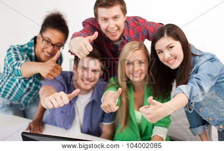 education, people, friendship and learning concept - close up of happy international high school students or classmates showing thumbs up