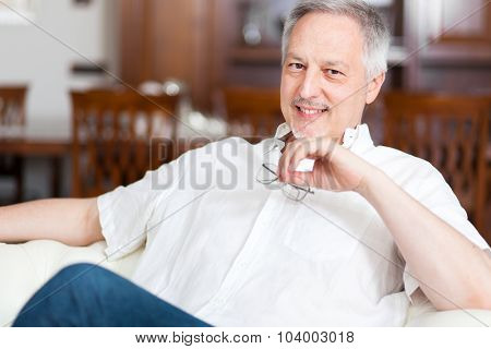 Portrait of a man relaxing in his apartment