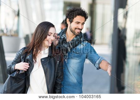 Happy couple shopping together in an urban street