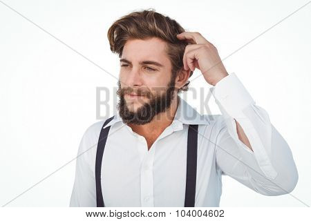 Hipster scratching head while thinking against white background