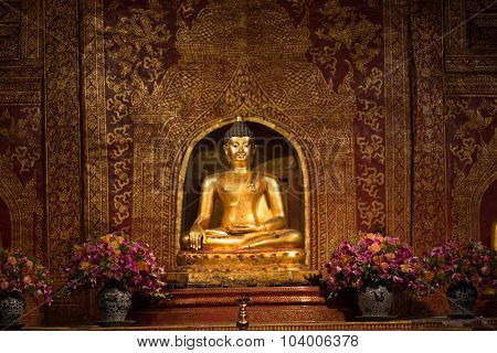 Thai golden buddha statue in wat phra singh temple, Chiang Mai