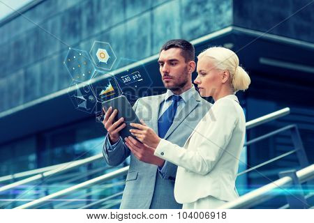 business, partnership, technology and people concept - businessman and businesswoman working with tablet pc computer charts on virtual screens on city street