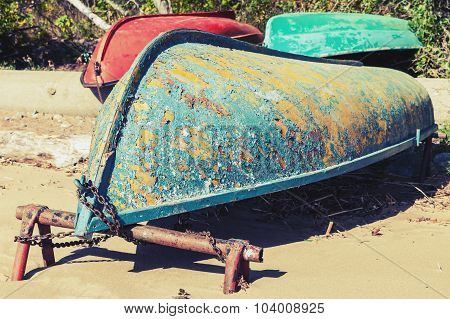 Old Rowboats Lay On Sandy Coast. Gulf Of Finland