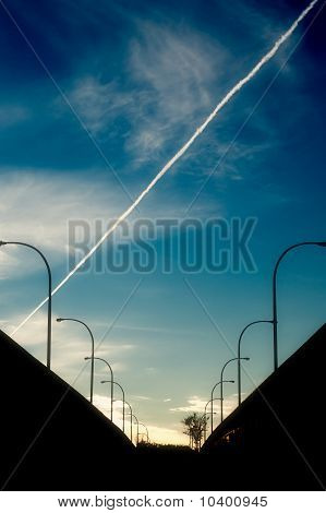Silhouettes Of Street Lights On Highway Bridge