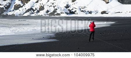 Photographer At The Black Sand Beach In Vik, Iceland