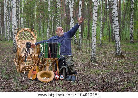 Senior musician invites people in park