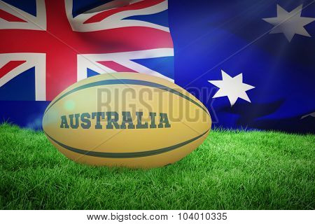 Australia rugby ball against close-up of australian flag
