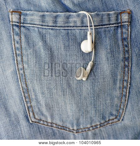 White Earbuds In Back Pocket Jeans