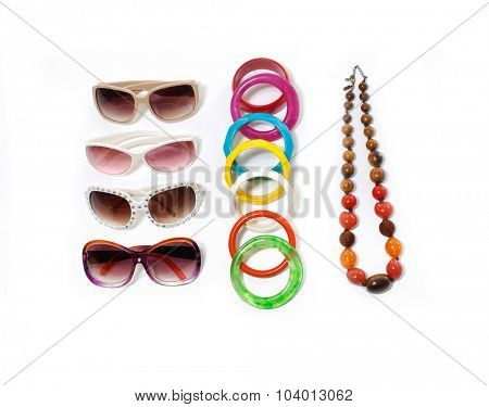 Colorful ball necklace with sunglasses and accessories on white background