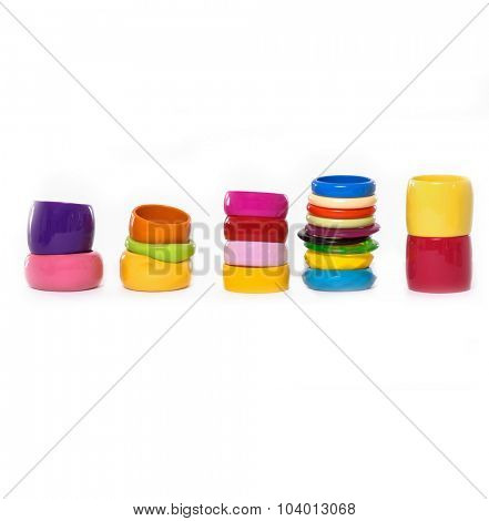 Pile of round modern colorful plastic bangles-white background