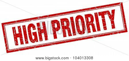 High Priority Red Square Grunge Stamp On White