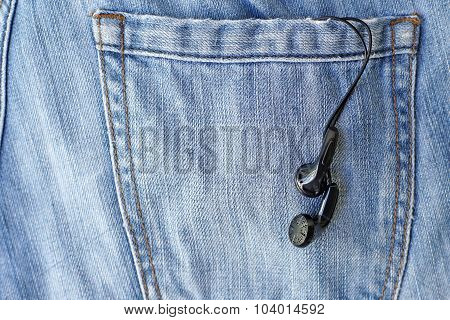 Black Earbuds In Back Pocket Jeans