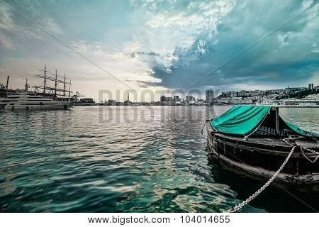 Italian Harbor Landscape With Boat And Genoa Ancient Lighthouse.