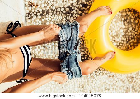Beautiful Slim Girl In Sexy Striped Bikini Pulls Off Her Shorts Near The Pool
