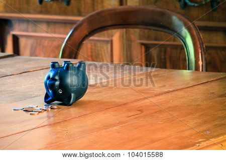 Piggy Bank On Wooden Table.