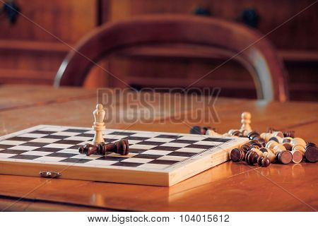 Chess Queens On Table.