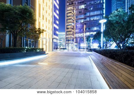 marble bricked square at night with trees around