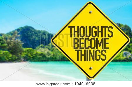 Thoughts Become Things sign with beach background