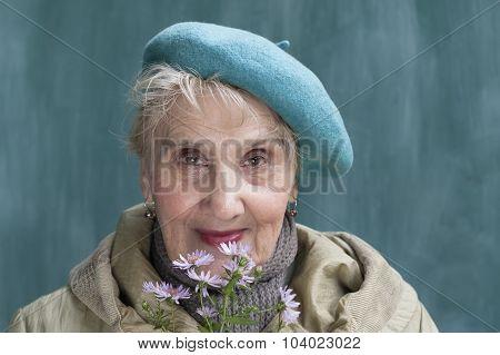 Happy Senior With Flowers