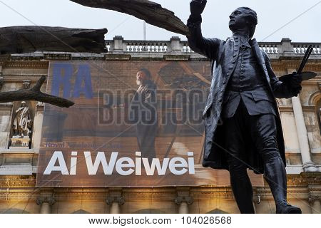 LONDON, UK - SEPTEMBER 23: Statue of Sir Joshua Reynolds with Ai Wei Wei's banner in the background, at the forecourt of the Royal Academy of Arts. September 23, 2015 in London.