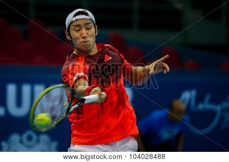 KUALA LUMPUR, MALAYSIA - SEPTEMBER 27, 2015: Yasutaka Uchiyama of Japan plays in his qualifying match at the Malaysian Open 2015 Tennis tournament held at the Putra Stadium, Malaysia.