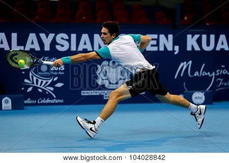 KUALA LUMPUR, MALAYSIA - SEPTEMBER 27, 2015: Mischa Zverev of Germany plays in his qualifying match at the Malaysian Open 2015 Tennis tournament held at the Putra Stadium, Malaysia.