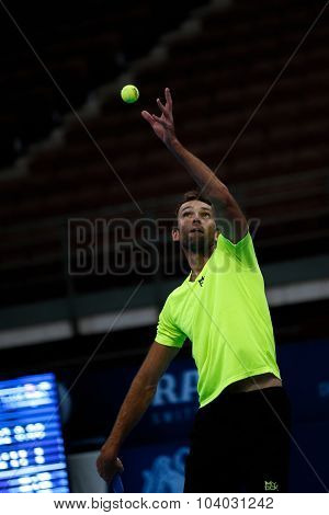 KUALA LUMPUR, MALAYSIA - SEPTEMBER 30, 2015: Ivo Karlovic of Croatia serves the ball in his match at the Malaysian Open 2015 Tennis tournament held at the Putra Stadium, Malaysia.