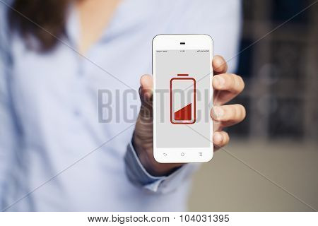 Woman Showing A Mobile Phone With Low Battery Icon In The Screen.