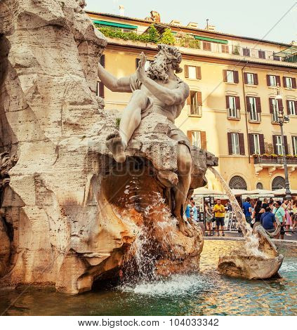 ROME, ITALY - JULY 9: Tourists visiting the famous Piazza Navona, fountain Four Rivers, July 9, 2015.