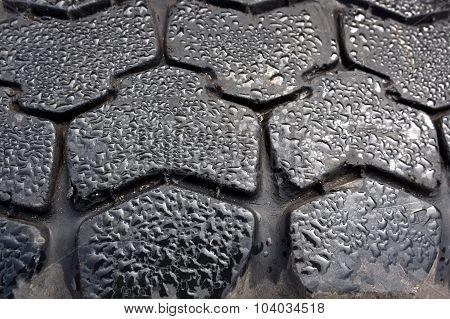 Raindrops On Tyre Closeup.