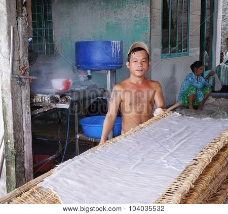 Vietnamese People Making Rice Noodles