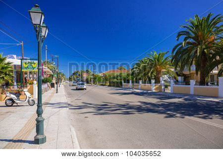 LAGANAS, GREECE - AUG 21, 2015: Main street of the Laganas town on Zakynthos island, Greece. Laganas is a very popular holidays destination full of nightclubs, bars, restaurants and souvenir shops.