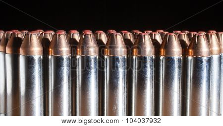 Line Of Cartridges With Red Tipped Bullets