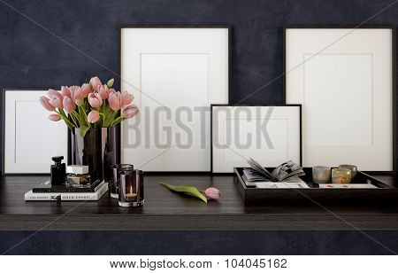 Blank picture frames on black table