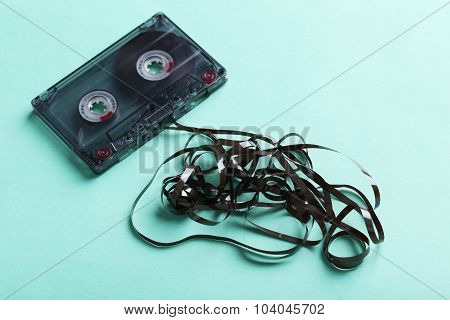 Audio Tape Cassette On Mint Paper Background