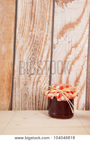 Home made fruit jam with wooden background