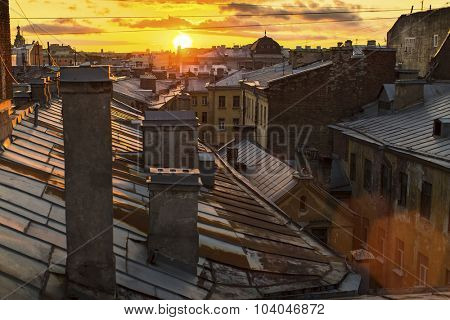 Amazing sunset on the roofs of St.Petersburg in Russia.