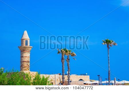 Minaret, walls and palm Arab period Caesarea. National park Caesarea on the Mediterranean Sea