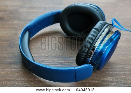 Headphones on wooden background