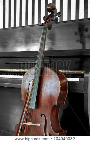 Cello near piano, closeup