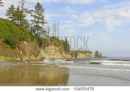 Rugged Cliffs On An Ocean Beach