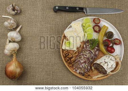 Delicious specialty food, salami with walnuts.