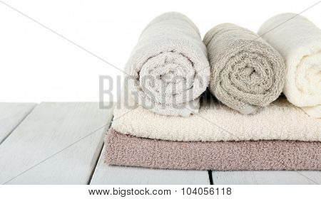 Soft towels on light background